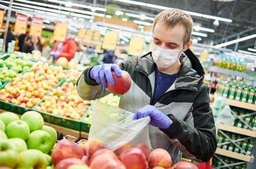 wear face mask and gloves to protect yourself from coronavirus when grocery shopping